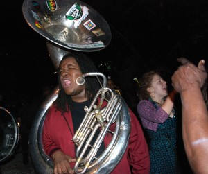 """Who dat?"" yells a tuba player from The Hustler Brass Band."