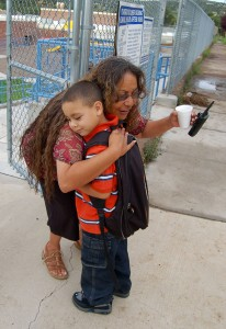 First day of school. This teacher was hugging every student as he/she walked off the bus. The Silver City Daily Press.