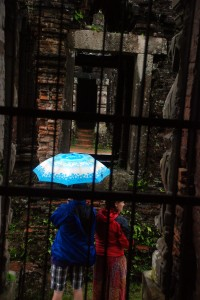 A couple looks into the ruins at My Son.